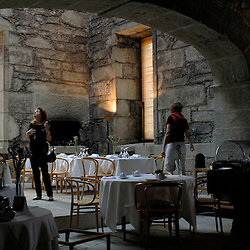 Santa Maria Do Bourho, Portugal - The former Cistercian monastery of Santa Maria Do Bourho, which was decaying after years of vacancy was restored with a modernist interpretation .  Here, the dining room sits in the monk's kitchen area where a giant skylight has been installed to flood the rear room with light...Photo by Susana Raab