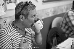 Bill Buckingham stopped for a cafe lunch during stage 6 of the Motorcycle Cannonball Cross-Country Endurance Run, which on this day ran from Cape Girardeau to Sedalia, MO., USA. Wednesday, September 10, 2014.  Photography ©2014 Michael Lichter.