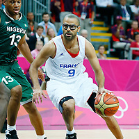 06 August 2012: France Tony Parker drives past Nigeria Derrick Obasohan during 79-73 Team France victory over Team Nigeria, during the men's basketball preliminary, at the Basketball Arena, in London, Great Britain.