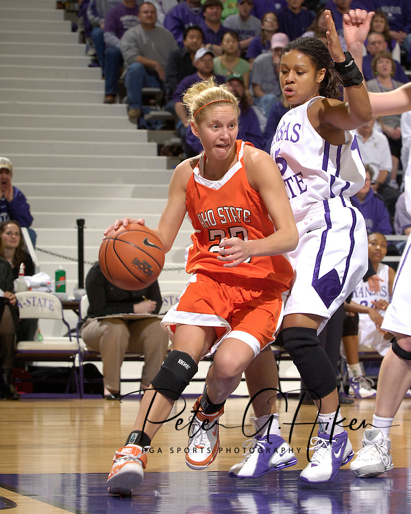 Idaho State guard Andrea Lightfoot (23) drives the baseline against pressure from Kansas State's Twiggy McIntyre (15) during the first half at Bramlage Coliseum in Manhattan, Kansas, March 17, 2006.  K-State defeated the Bengals 88-68 in the first round of the WNIT.