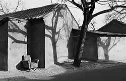Shadows on walls of old houses in a Beijing hutong