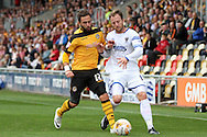 Sean Rigg of Wimbledon (right) is challenged by Robbie Willmott of Newport. Skybet football league two match, Newport county v AFC Wimbledon at Rodney Parade in Newport, South Wales on Saturday 27th Sept 2014<br /> pic by Mark Hawkins, Andrew Orchard sports photography.