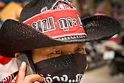 16 APRIL 2010 - BANGKOK, THAILAND:  A Red Shirt protestor wears a cowboy style hat. The Red Shirts continue their protest at Ratchaprasong Intersection in the heart of Bangkok's upscale shopping and hotels. They are calling on Prime Minister to step down and dissolve the parliament. Most of the Red Shirts support former Prime Minister Thaksin Shinawatra, who was deposed by a military coup in 2006 and is now living outside of Thailand. The Red Shirts want Thaksin to return to Thailand.   PHOTO BY JACK KURTZ