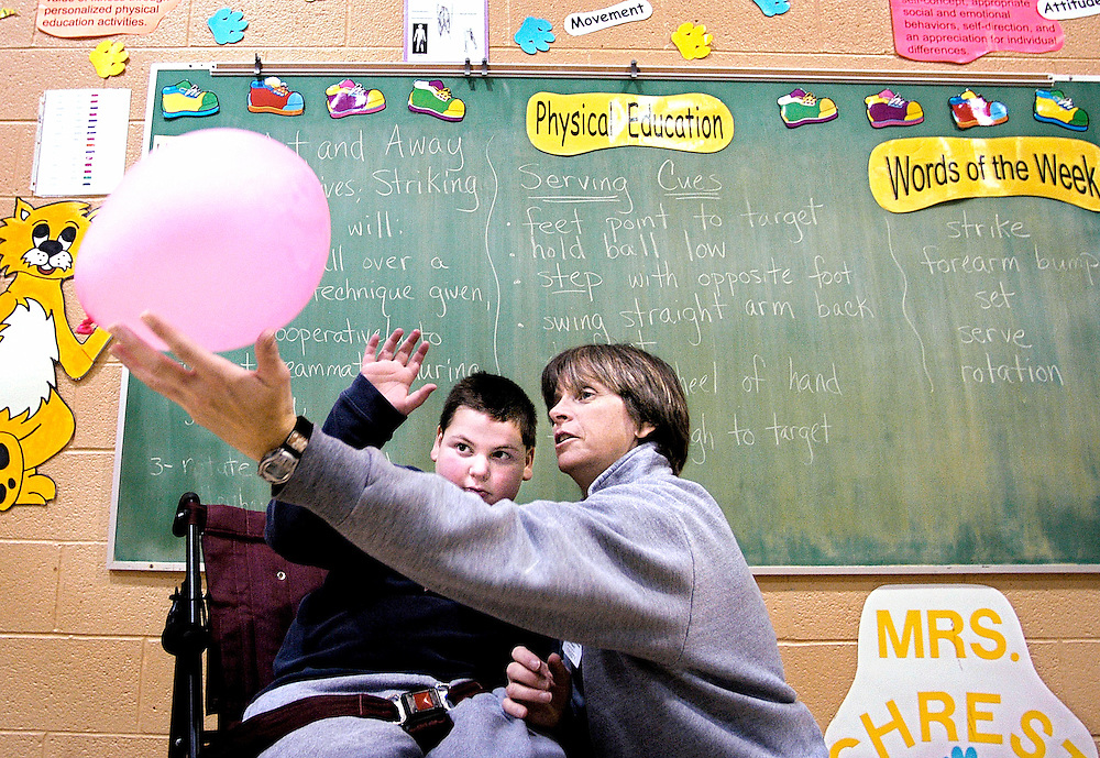 Students from Waverly Elementary School with developmental disabilities participate in their weekly PE inclusion class Thursday January 27, 2005. Lynn Frost, right, has taught adapted physical education for 20 years and teaches at different schools in the Howard County School system throughout the week, but she is based at Waverly. She is teaching Ryan Stewart, left, 4th grade, 8 years, old from Ellicott City, pushing motions.
