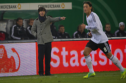 15.11.2011, Imtech Arena, Hamburg, GER, FSP, Deutschland (GER) vs Holland (NED), im Bild Joachim Löw/ Loew ( GER #Coach) Mesut Özil/ Oezil GER #08 Madrid) // during the Match Gemany (GER) vs Netherland (NED) on 2011/11/15, Imtech Arena, Hamburg, Germany. EXPA Pictures © 2011, PhotoCredit: EXPA/ nph/ Kokenge..***** ATTENTION - OUT OF GER, CRO *****