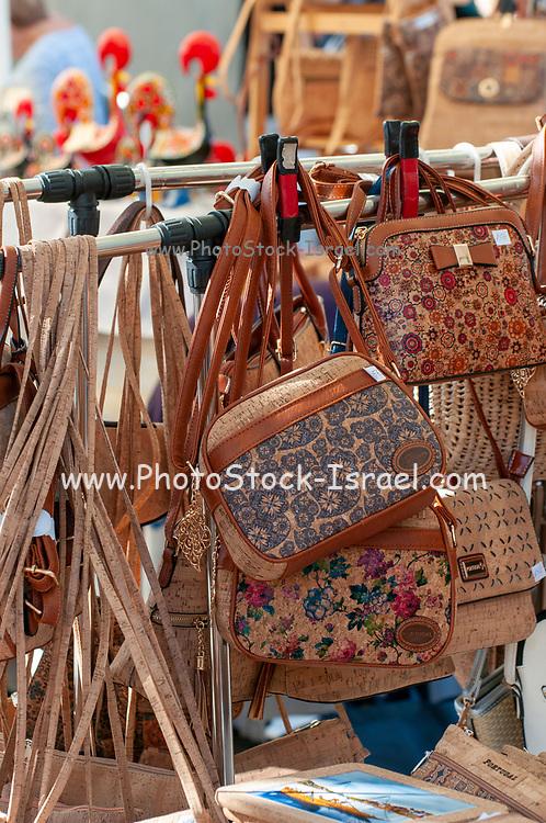 Stalls selling handicraft in an open air market on the banks of the Douro River in Vila Nova de Gaia, Porto, Portugal