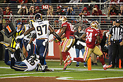San Francisco 49ers running back Shaun Draughn (24) carries the ball into the end zone for a touchdown against the Los Angeles Rams at Levi's Stadium in Santa Clara, Calif., on September 12, 2016. (Stan Olszewski/Special to S.F. Examiner)