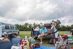 man in South Carolina selling things at a flea market