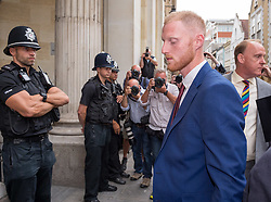 © Licensed to London News Pictures. 06/08/2018. Bristol, UK.  England cricketer BEN STOKES (blue suit) arrives at Bristol Crown court today for the start of his trial on charges of affray that relate to a fight outside a Bristol nightclub on September 25 2017. Stokes and two other men, Ryan Ali, 28, and Ryan Hale, 27, all deny the charge. Stokes, Ali and Hale are jointly charged with affray in the Clifton Triangle area of Bristol on September 25 last year, several hours after England had played a one-day international against the West Indies in the city. A 27-year-old man allegedly suffered a fractured eye socket in the incident. Photo credit: Simon Chapman/LNP