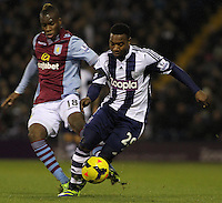 West Bromwich Albion's Stephane Sessegnon in action against Aston Villa's Yacouba Sylla.<br /> <br /> Photo by James Marsh/CameraSport<br /> <br /> Football - Barclays Premiership - West Bromwich Albion v Aston Villa - Monday 25th November 2013 - The Hawthorns - West Bromwich<br /> <br /> © CameraSport - 43 Linden Ave. Countesthorpe. Leicester. England. LE8 5PG - Tel: +44 (0) 116 277 4147 - admin@camerasport.com - www.camerasport.com