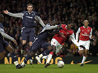 Photo: Olly Greenwood.<br />Arsenal v Bolton Wanderers. The FA Cup. 28/01/2007. Arsenal's Emmanuel Adebayor is tackled  by Bolton's Abdoulaye Faye but no penalty is given