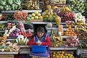 A vendor cleans corn as she waits for customers in the Santa Carolina Market in Quito, Ecuador.  Grocery stores, supermarkets, and megamarkets all have their roots in village market areas where farmers and vendors would converge once or twice a week to sell their produce and goods. In farming communities, just about everyone had something to trade or sell. As transportation became more efficient (especially refrigerated transport), and farms became huge, big corporations moved into the food business to take advantage of scale, especially in the United States. Now the convenience of one-stop shopping has made this business even bigger. Even the smaller supermarkets are being bought up or run out of business by the larger concerns. Some small town markets still exist today throughout much of Europe, although to a lesser degree there as well. Small markets are still the lifeblood of communities in the developing world, and, for better or worse, will remain so until they are numerous and big enough to attract the conglomerates' attention. Coming full circle, farmers markets have come back into vogue in some places in the USA where they had largely disappeared.