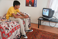 Asian youth watching television.