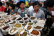Sellers and buyers mingle and trade medicine at a traditional Chinese medicine market in Bozhou, Anhui Province, China on 03 August, 2011. The birth place of legendary doctor Hua Tuo, Bozhou is now one of the four major trading centers in China for traditional Chinese medicine.