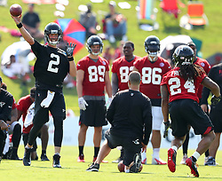 July 27, 2017 - Flowery Branch, GA, USA - Matt Ryan throws a pass to running back Devonta Freeman on the first day of team practice at the Atlanta Falcons' training camp on Thursday, July 27, 2017, in Flowery Branch, Ga. (Credit Image: © Curtis Compton/TNS via ZUMA Wire)