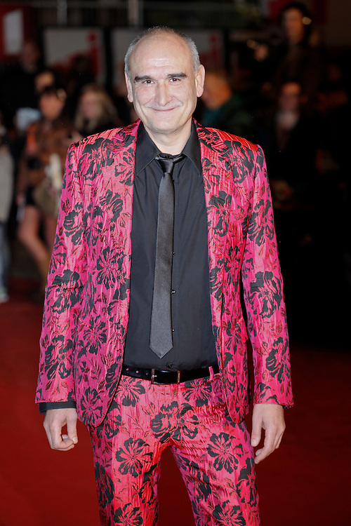 Pascal Negre poses as he arrives at NRJ Music Awards 2012 at Palais des Festivals on January 28, 2012 in Cannes.Pascal Nègre  arrive au NRJ Music awards 2012 au Palais des Festivals le Janvier 28 2012 à Cannes.