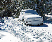 It snowed last night. This vehicle is covered and won't be going anywhere soon. I dug a path from the house to the street (but the street hadn't been cleared yet). Image taken with a Nikon D300 camera and 18-200 mm VR lens (ISO 200, 48 mm, f/13, 1/800 sec).