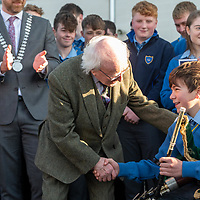 President Higgins thanks piper Fergus Walsh from Belgooly for his music at the start of a visit to Kinsale Community School.<br /> Picture. John Allen