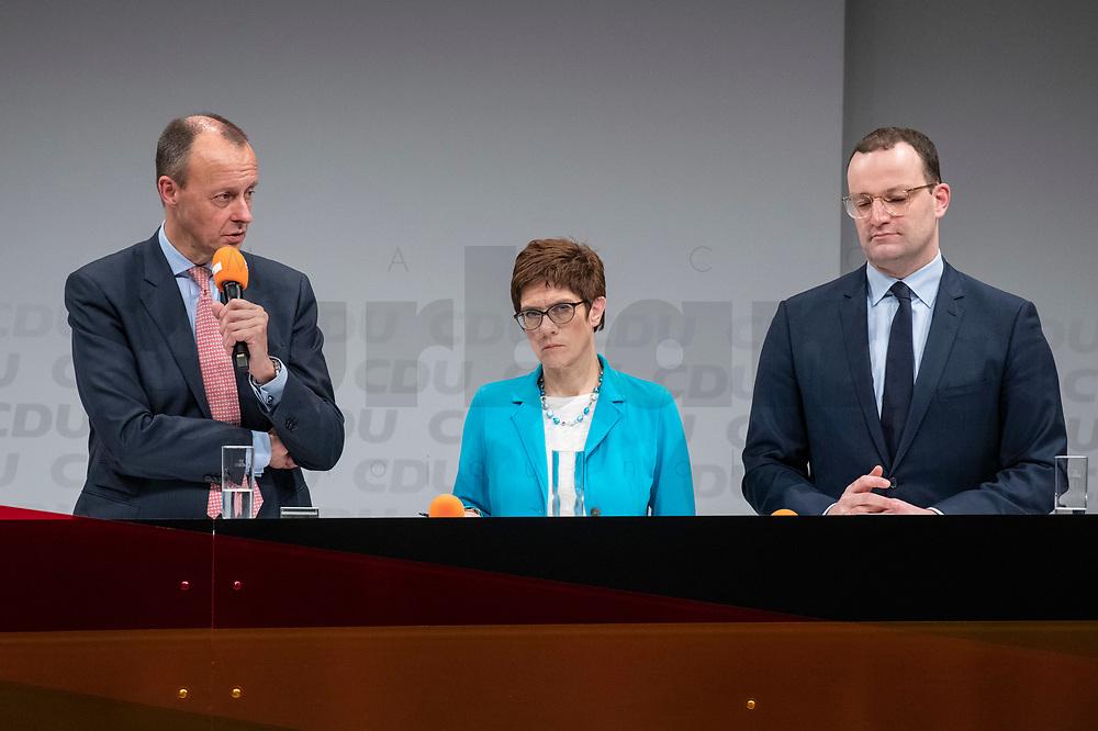 30 NOV 2018, BERLIN/GERMANY:<br /> Friedrich Merz (L), CDU, Rechtanwalt und ehem. stellv. CDU/CSU Fraktionsvorsitzender, Annegret Kramp-Karrenbauer (M), CDU Generalsekretaerin, und Jens Spahn (R), CDU, Bundesgesundheitsminister, waehrend der Fragerunden der Teilnehmer,  Regionalkonferenz der CDU zur Vorstellung der Kandidaten fuer das Amt des Bundesvorsitzenden der CDU, Estrell Convention Center<br /> IMAGE: 20181130-01-051