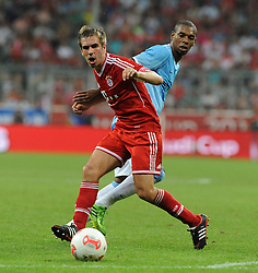 01.08.2013, Allianz Arena, Muenchen, Audi Cup 2013, FC Bayern Muenchen vs Manchester City, im Bild, Philipp LAHM (FC Bayern Muenchen) gegen FERNANDINHO (Manchester City) // during the Audi Cup 2013 match between FC Bayern Muenchen and Manchester City at the Allianz Arena, Munich, Germany on 2013/08/01. EXPA Pictures © 2013, PhotoCredit: EXPA/ Eibner/ Wolfgang Stuetzle<br /> <br /> ***** ATTENTION - OUT OF GER *****
