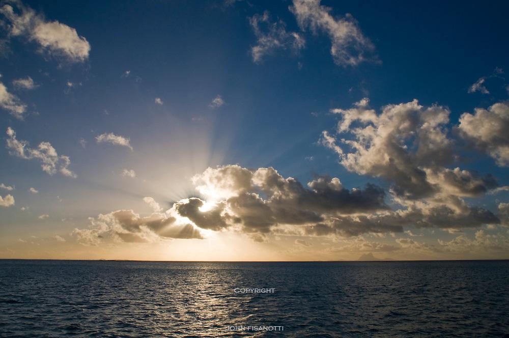 Bora Bora is visible on the distant horizon