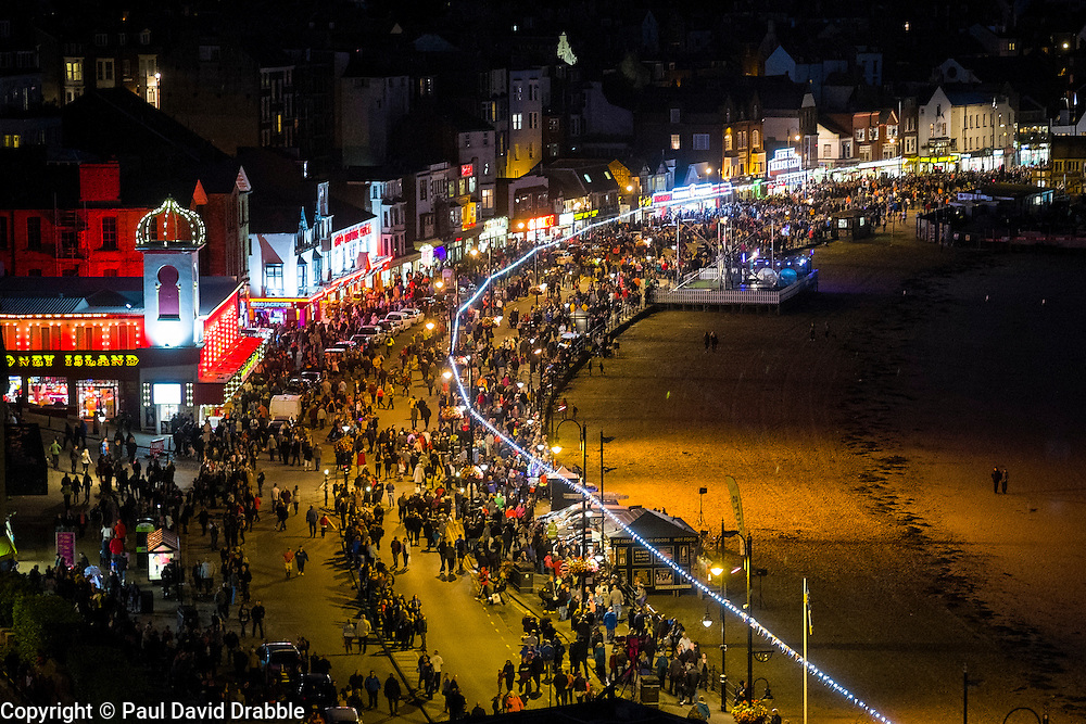 Crowds flood onto the the road after the Scarborough Goldwing Light Parade 2015 from the terrace of the Grand Hotel<br />  11 September 2015<br />  Image © Paul David Drabble <br />  www.pauldaviddrabble.co.uk