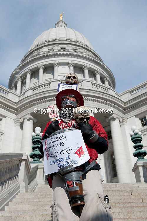 """A silent protester walks the grounds of the state Capital on March 1, 2011 in Madison, Wisconsin. Despite a court order issued Tuesday mandating that the state Capitol should be opened to the public """"during business hours and at times when governmental matters, such as hearings, listening sessions and court arguments are being conducted"""" the Capitol remained closed to the public.      (Photo by Brian Kersey)"""