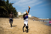 Boys and young men play on the beach in Cape Coast, Ghana on Sunday September 7, 2008.