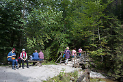Hikers rest on the footpath near Sarnia Skala, a mountain in the Tatra National Park, on 16th September 2019, near Koscielisko, Zakopane, Malopolska, Poland.