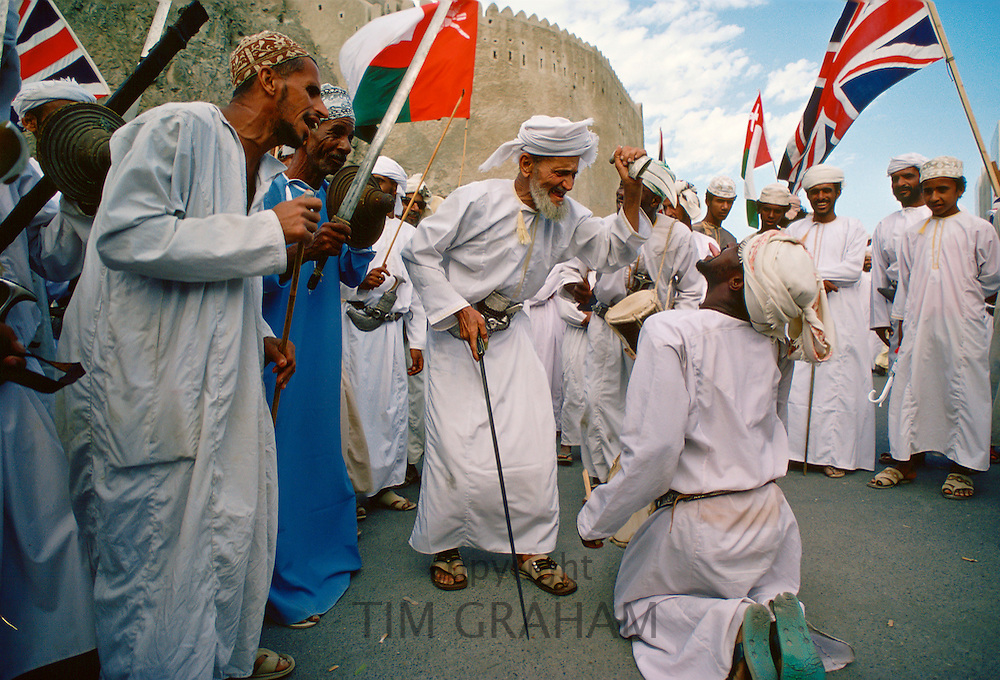 Men performing outside Sultan Qaboos' Royal Palace, Muscat, Oman