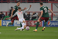 MOSCOW, RUSSIA - OCTOBER 27: Thomas Müller of FC Bayern Muenchen shoots at goal with Murilo Cerqueira of Lokomotiv Moskva behind him during the UEFA Champions League Group A stage match between Lokomotiv Moskva and FC Bayern Muenchen at RZD Arena on October 27, 2020 in Moscow, Russia. (Photo by MB Media)