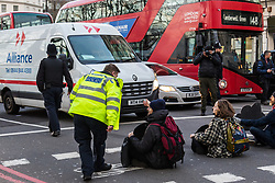 Demonstrators from the anti-pollution group Stop Killing Londoners cause traffic chaos for London commuters as they conduct a series of short roadblocks at Marble Arch stopping cars and buses from entering Oxford Street and Park Lane. Irate motorists accused them of creating more pollution than they were stopping, whilst the group said their objectives were long term. A leaflet handed out to motorists says the government is not doing enough to tackle the crisis costing 'taxpayers and the NHS £billions [sic] a year'. PLACE, January 29 2018. © Paul Davey
