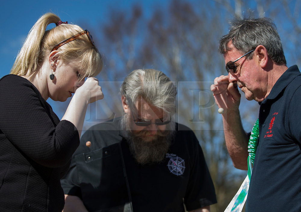 © Licensed to London News Pictures. 25/03/2016. Crawley, UK. Players make a nose drop shot to decide which team goes first in the World Marbles Championships in the car park of the Greyhound pub in Tinsley Green near Crawley. The competition has taken place every year since 1932 with teams from the USA, Algeria, Australia and Europe taking part. Photo credit: Peter Macdiarmid/LNP