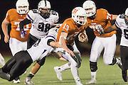 Westwood quarterback Jack Swensen gets tackled by Cedar Ridge's Brandon Zientek Friday at Dragon Stadium.