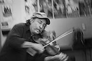Kelly Thibodeaux gave series of violin workshops in the Sisters School District.  He was photographed at Sisters Elementary school and Sisters High school.  2013