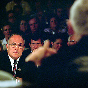 """Rudolph """"Rudy"""" Guiliana, Mayor of New York City, testifying at the 9/11 Commission's 11th Public Hearing in New York City. Bob Kerrey is in the foreground, seen from behind."""