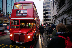 © Licensed to London News Pictures. 09/01/2017. London, UK.  A old route master bus waits to collect commuters at Victoria station in London on the second day of a 24 hour tube strike.  All Zone one tube stations are closed until 6PM tonight after members of the RMT and the Transport Salaried Staffs' Association unions walked out after talks with TFL collapsed. Photo credit: Ben Cawthra/LNP