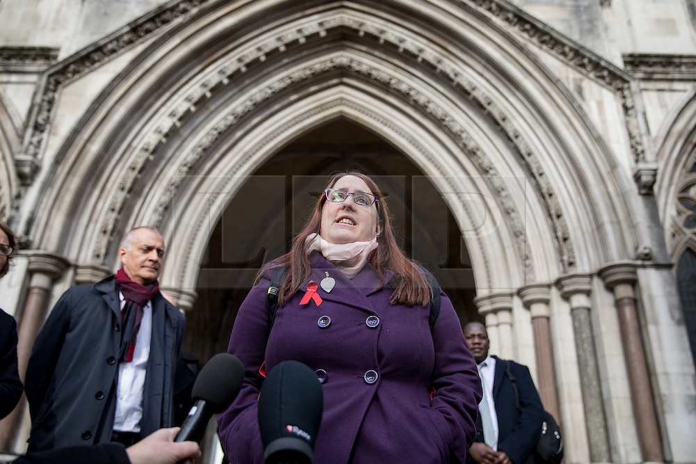 """© Licensed to London News Pictures. 10/11/2016. London, UK. Deborah Gold, Chief Executive of National AIDS Trust makes a statement outside the High Court, as NHS England lose their appeal against a High Court Judge, who ruled that the body has the power to commission pre-exposure prophylaxis (PrEP), a drug described as a """"game changer"""" in the fight against HIV/AIDs. NHS England argued that providing the drug was not its responsibility, and it was for local councils to fund """"preventative"""" health treatment. Photo credit : Tom Nicholson/LNP"""