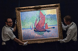 "© Licensed to London News Pictures. 08/04/2016. London, UK. Sotheby's technicians carry André Derain's ""Les Voiles Rouges"", 1906, est. $15-20million at Sotheby's auction preview, at their New Bond Street gallery, of works to be in the upcoming New York Impressionist, modern and contemporary art sale. Photo credit : Stephen Chung/LNP"