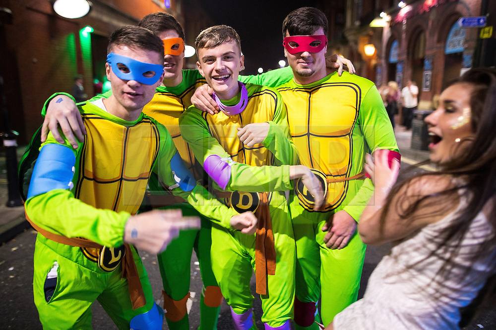 © Licensed to London News Pictures . 27/12/2016 . Wigan , UK . Four men wearing Teenage Mutant Ninja Turtles themed outfits . Revellers in Wigan enjoy Boxing Day drinks and clubbing in Wigan Wallgate . In recent years a tradition has been established in which people go out wearing fancy-dress costumes on Boxing Day night . Photo credit : Joel Goodman/LNP
