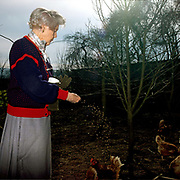A lifelong lover of chickens, Deborah Devonshire feeds her brown and buff crossbreeds at her home on the Chatsworth Estate, Derbyshire. Deborah Vivien Cavendish, the Dowager Duchess of Devonshire, née The Hon. Deborah Freeman-Mitford, is the youngest and last surviving of the six Mitford sisters whose political affiliations and marriages were a prominent feature of English culture in the 1930s and 1940s.
