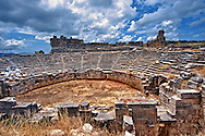 Ampitheatre of Xanthos that has been modified by the Romans with a wall around what would have been the stage to make a pit for Gladitorial & animal events. Xanthos UNESCO World Heritage Archaeological Site, Turkey.<br /> <br /> If you prefer to buy from our ALAMY PHOTO LIBRARY  Collection visit : https://www.alamy.com/portfolio/paul-williams-funkystock/xanthos-lycian-turkey.html<br /> <br /> Visit our ANCIENT WORLD PHOTO COLLECTIONS for more photos to download or buy as wall art prints https://funkystock.photoshelter.com/gallery-collection/Ancient-World-Art-Antiquities-Historic-Sites-Pictures-Images-of/C00006u26yqSkDOM