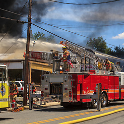 Columbia, PA, USA - June 27, 2012: Firefighters battle a massive fire at a motorcycle shop in Columbia.