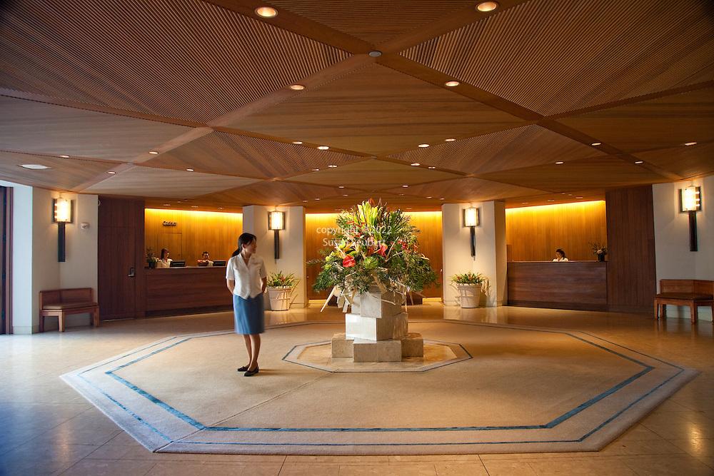 The Halekulani Hotel, the Hawaiian name meaning House Befitting Heaven, located on Waikiki beach in Honolulu, Hawaii offers stunning views of Diamond Head in a historic, secluded and exclusive setting. The lobby of the Halekulani.