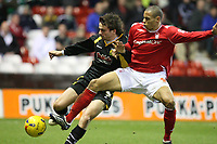Photo: Pete Lorence.<br />Nottingham Forest v Yeovil Town. Coca Cola League 1. 13/01/2007.<br />Nathan Tyson tackles Arron Davies.