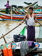 22 NOVEMBER 2017 - YANGON, MYANMAR: A boatman waits for customers on the Twante Canal in Yangon. The small boats shuttle passengers across the canal or up and down the canal to other piers in Yangon.    PHOTO BY JACK KURTZ