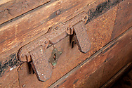A heavy metal lock built into the front of a steamer trunk in the C-Scape dune shack.