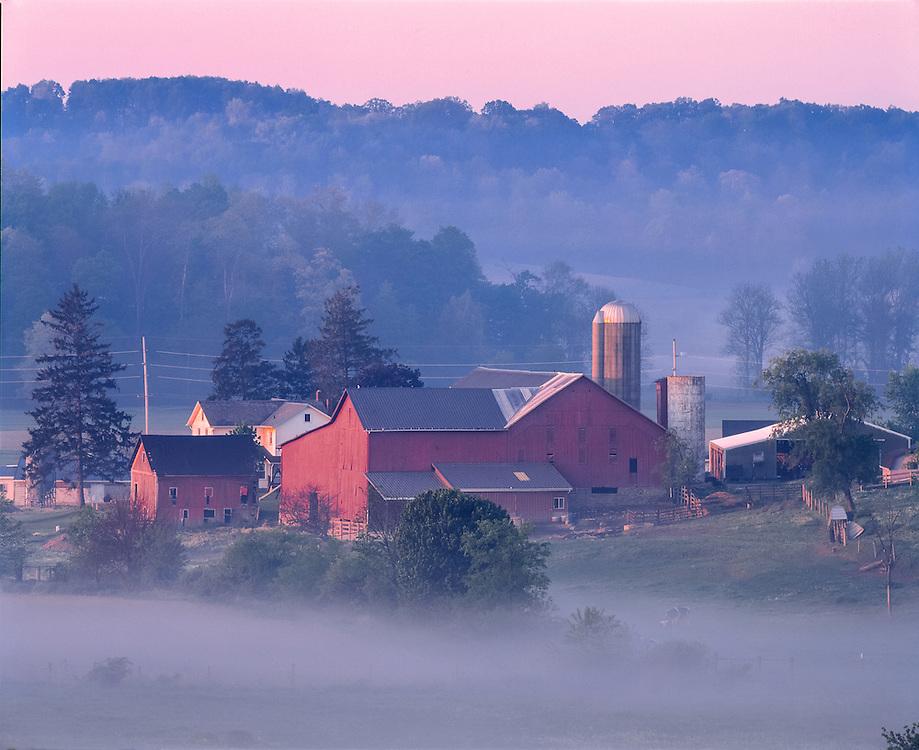 Amish Farm with fog, barns & outbuildings, hills, Walnut Creek OH