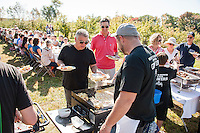 """Local Eatery's Glenn LeClair and Chef Kevin Halligan serve up sweet potatoes with smoked chicken and arugula along with a ham, cheddar and apple omelet during the """"Breakfast at the Orchard"""" Sunday morning at Smith's Orchard in Belmont.  (Karen Bobotas/for the Laconia Daily Sun)"""