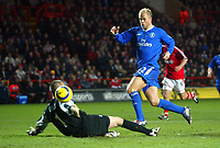 27/11/2004 - FA Barclaycard Premiership - Charlton Athletic v Chelsea - The Valley<br />Chelsea's Eidur Gudjonsen chips the ball over Charlton Athletic's  goalkeeper Dean Kiely to score the 4th Chelsea goal.<br />Photo:Jed Leicester/Back Page Images